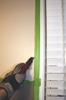 Score the dried paint before removing tape Paint a Decorative Border