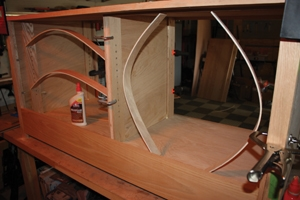 Bowed strips of wood as tension clamps