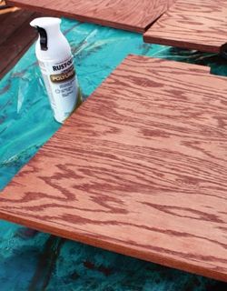 Cherry-toned wood stain and several coats of polyurethane.