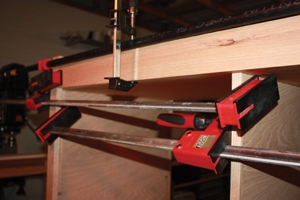 Clamps and spreaders encourage the face-frames to align