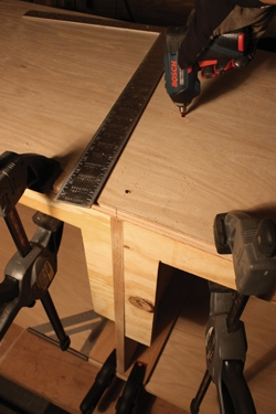 Use Plywood braces to position the center divider