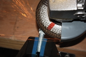 Grinding down the head of the bolt