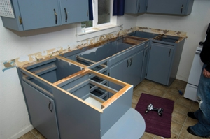Reconfiguring kitchen cabinets to install a dishwasher for Can you replace kitchen cabinets without replacing countertop