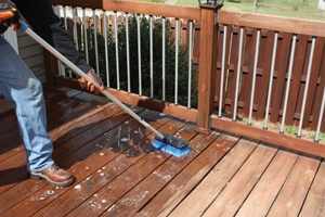 Scrub the deck surface