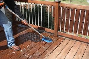 Scrub the deck surface