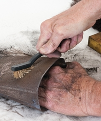 A brass brush can get in pits and creases too