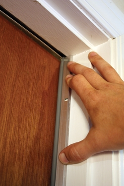 Position the strip against the closed door. & Installing Aluminum Weather-Stripping - Extreme How To Pezcame.Com