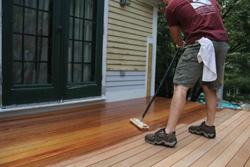 Before completing the rail system, exterior wood stain was applied while the crew had unobstructed access to the decking