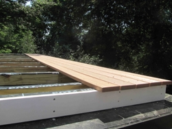 After sheathing and trim boards were installed, the deck boards came next.