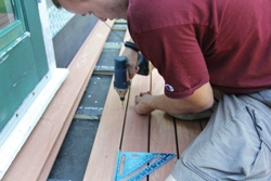 "The mahogany deck boards were installed with stainless steel screws and spaced 1/4"" apart."