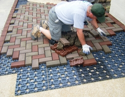 AZEK Pavers being laid on grid