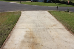 After edging, the driveway perimeter looks crisp and clean.