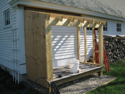 The walls as well as the roof received ½-in. CDX plywood sheathing.