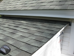 The new roofing shingles matched the existing house roof.