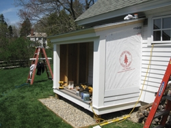 The walls were then sided with pre-primed Western Red Cedar clapboard.