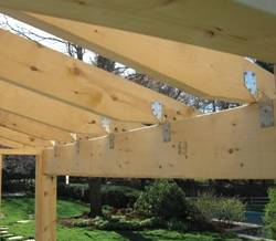 "The 2x6 rafters were installed and additionally supported with rafter clips or ""hurricane ties""."