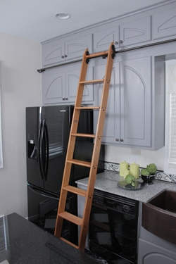 Ladders come in all shapes and sizes, such as this wooden kitchen ladder from Putnam Rolling Ladders, which allows convenient access to overhead storage cabinets.