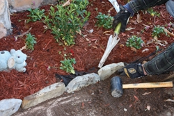 More than half the stone should rest below grade. Backfill around the stones and pack the soil firmly.