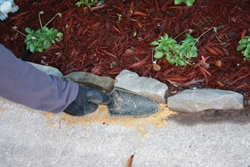 Finally, I packed the joints with sand to help prevent garden soil washing onto the drive-way when it rained.