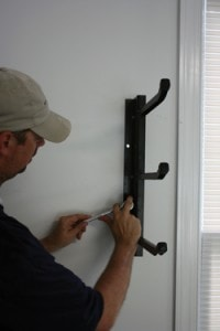 The Racor 450 Rack comes with heavy-duty lag screws that must be mounted to stud framing.