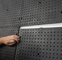 The edges of the Racor panels interlock at the screw holes and with tabs at the top and bottom.