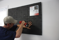 The interlocking pegboard panels self-align during installation, so after plumbing the first one you can complete the job without using a hand level.