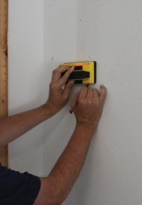 When mounting a pegboard or any wall-mount storage device, you'll always get the most holding power by fastening into the studs.