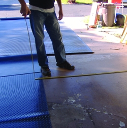 Measure carefully when cutting the floor cover to fit around obstructions.