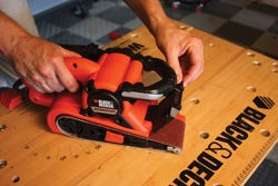 The Black & Decker Dragster belt sander has a low-profile nose and retractable guard that allow sanding in small spaces.