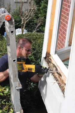 A reciprocating saw is a handy tool for digging out the rotted wood.