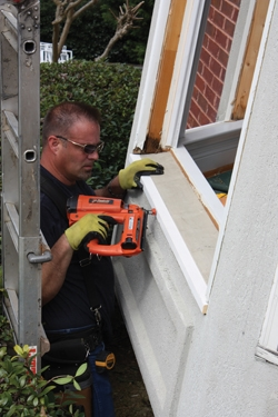 Damon Gassaway of Lifetime Windows & Doors installs the new window sill.