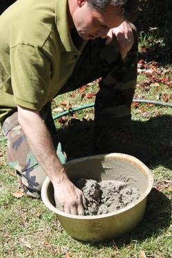 We mixed up small amounts of Sakrete masonry mortar in an old wash pan.