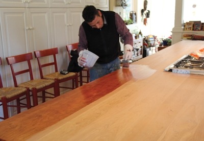 We applied the finish to the wood in 4x4' areas using a high-quality brush.