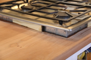 We used small spacer wood blocks to lift the cook-top off the counter.
