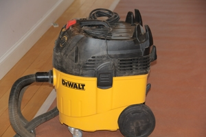 We used a tool-activated HEPA vacuum by Dewalt to capture the saw dust. The Dewalt vacuum turns on when the sander is turned on.