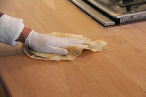 Wipe down the countertop several times with a tack cloth to remove all wood dust.