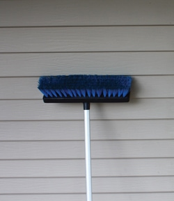 Cleaning a home's siding can brighten the color tone by several shades.
