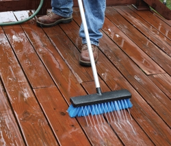 The Deck Washer from HomeRight uses a standard garden hose combined with a long-handled brush to scrub the boards with pressurized water.