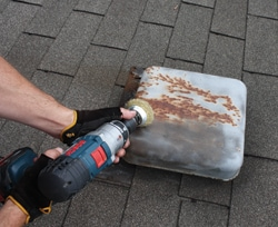 Rust on metal roof accessories can be removed with a wire brush—handheld or drill-mounted. Lay on some fresh primer and paint to renew their appearance.