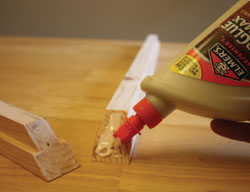 Apply glue to the corners and clean up any excess that squeezes from the joint.