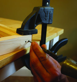 Set the nail heads below the wood surface to leave room for wood filler.