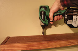 Fasten the shelf to the cleat with wood screws.