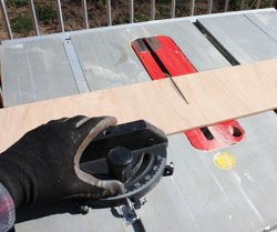 Trim the plywood to fit inside the groove.