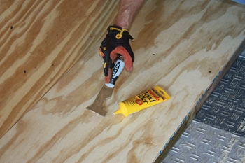 Fill the nail holes with wood putty and sand smooth to avoid snaggling the corners of the sheet goods.