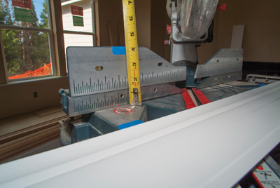 Use masking tape to mark the edges of the crown on the miter saw's table and fence so it is positioned at the correct angle to the saw blade.
