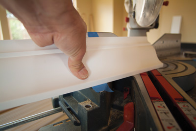 Since the crown goes on the saw upside-down, put the ceiling mark on the table and the wall mark on the fence. Begin a cope cut by making a 45-degree miter back toward the length of the board.