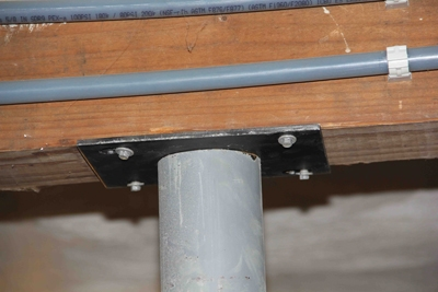 The top plate screws flush and securely to the beam.