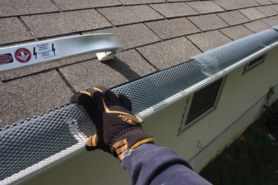 Check the roof for worn or missing shingles and flashing. Use binoculars to inspect all roof penetrations, including the chimney. Make sure the gutter is free of leaks and clogs. Gutter covers help to keep leaves and debris from accumulating and impeding drainage.