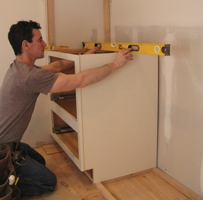 Again, layout, level and plumb are key—especially as you get started building the towers. Check the top of the cabinet to make sure it's level.