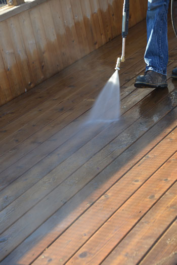"If you are power washing, always use as low a pressure as possible—between 500 to 600 psi. As a rule of thumb, try to never get closer than 12"" to the wood deck."